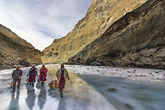 PORTERS ON FROZEN RIVER
